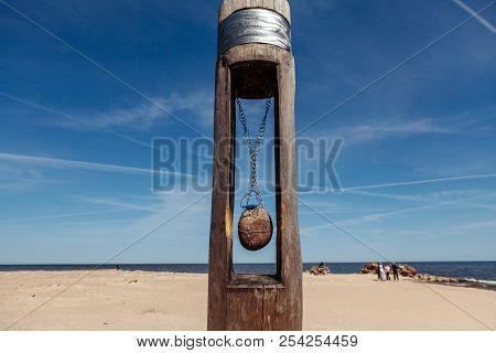 A Stone Hanging On A Chain On Kolka Cape, Latvia