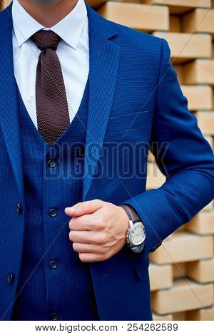 Businessman Style. Men Style. Man In Custom Tailored Business Suit Posing Outdoors.