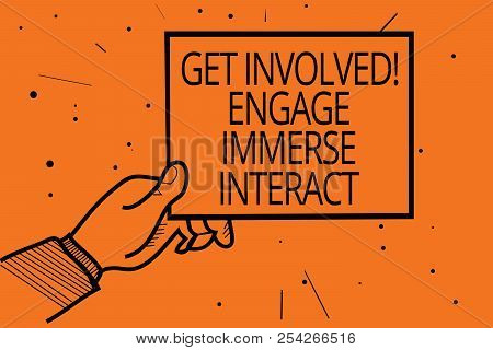 Writing note showing Get Involved Engage Immerse Interact. Business photo showcasing Join Connect Participate in the project Man hand holding paper communicating information dot orange background. poster