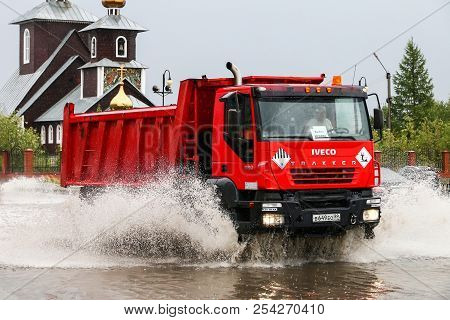 Novyy Urengoy, Russia - August 14, 2018: Red Dump Truck Iveco Amt Trakker In The City Street During