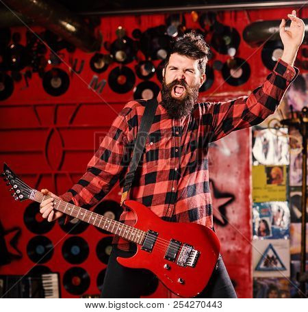Frontman Concept. Talented Musician, Soloist, Singer. Musician With Beard Play Electric Guitar Instr