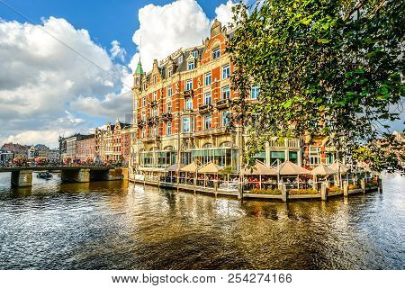 Amsterdam, Netherlands - October 1 2016: Tourists And Local Dutch Enjoy An Early Autumn Afternoon As