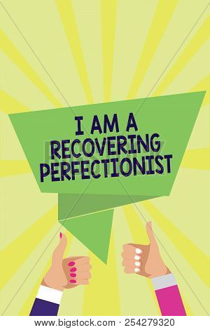 Handwriting text I Am A Recovering Perfectionist. Concept meaning Obsessive compulsive disorder recovery Man woman hands thumbs up approval speech bubble origami rays background. poster