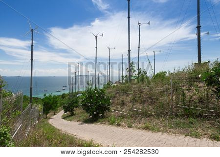 Wind Turbines And Blue Sea At Thailand