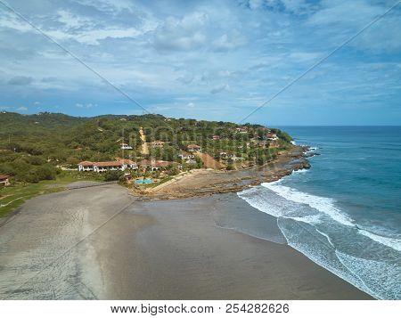 Luxury House On Ocean Coastline Aerial View On Summer Day