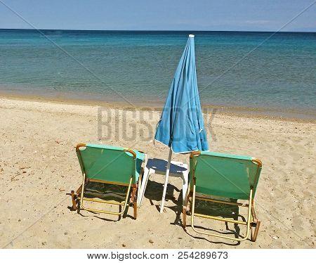 The Mediterranean Sea In Greece, Sunbed On The Beach