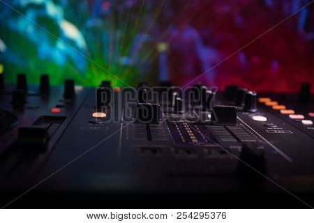 In Selective Focus Of Pro Dj Controller.the Dj Console Deejay Mixing Desk At Music Party In Nightclu