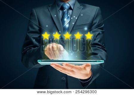Feedback, Review And Increase Rating Concepts. Digital Tablet User Give Five Stars In His Review And