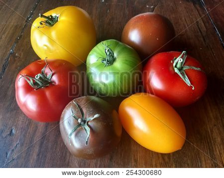 Seven Beautiful Heirloon Tomatoes Of Different Color: All The Same, But All Different