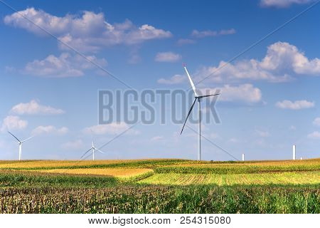 Renewable Energy With Wind Turbines In The Green Fields