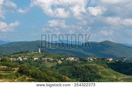 Village Of Kojsko, Sloveniain Famous Wine Growing Region Of Goriska Brda, Lit By Sun And Clouds In B