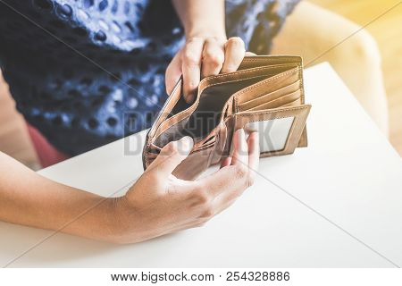 Broke woman hands holding Empty wallet,Concept having cost control expenses,No money poster