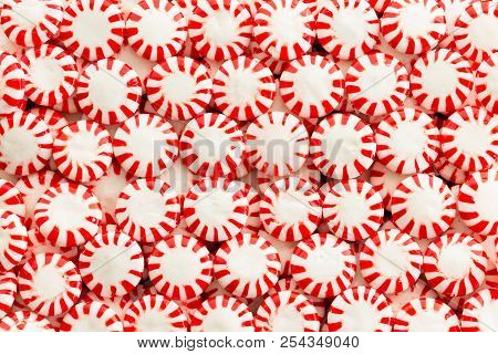 Background Texture Of Closely Popular Mint Flavored Red And White Packed Starlight Candy I Neat Rows