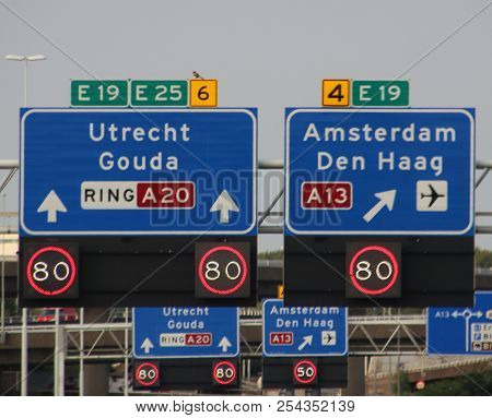 Direction And Mandatory Speed Sign Above Motorway A20 With Split Between Rotterdam And To The Hague