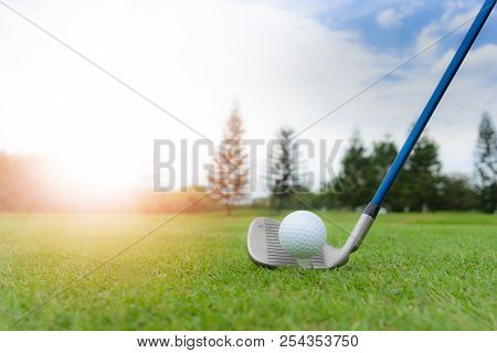 Golf concept : Golf ball on golf course, an 8 iron set up for fairway shot. With artificial sunlight and copy space. poster