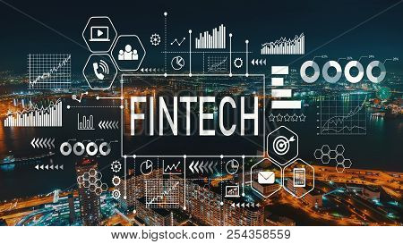 Fintech With Aerial View Of  City Skylines At Night