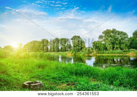 River, Trees And A Summer Dawn. Summer Landscape - River, Surrounded By Trees, A Place For A Campfir