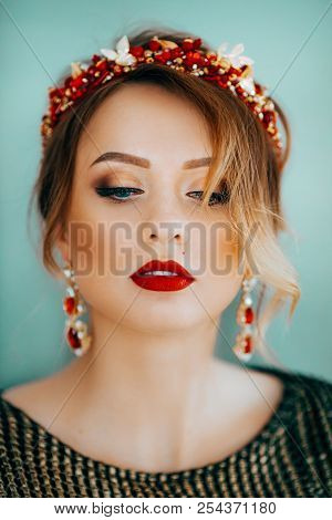 Portrait of beautiful young woman with makeup in chaplet poster