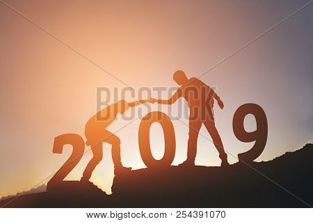 Friend Hiking Help Each Other Silhouette In 2019 New Year On Mountains
