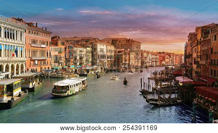 Venice, Italy, Jun 8, 2018: View Of Vaporetto And Gondolas With Tourists On Grand Canal In Venice, I