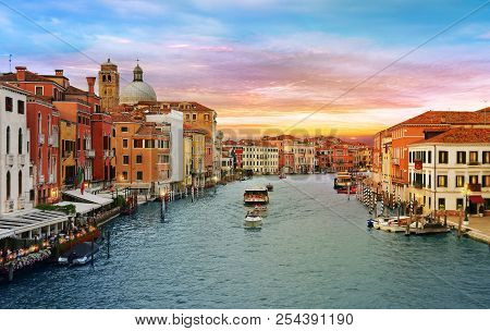 Venice, Italy, Jun 8, 2018: View Of Vaporetto And Boats On Grand Canal With Colorful Buildings Aroun