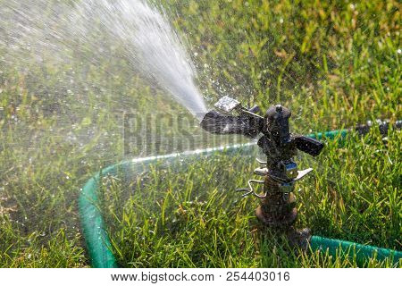 Watering The Lawn To Keep It Nice And Green