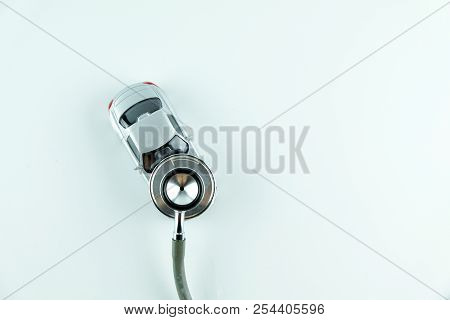 Stethoscope Checking Up The Car On White Background, Concept Of Car Check Up, Repair And Maintenance