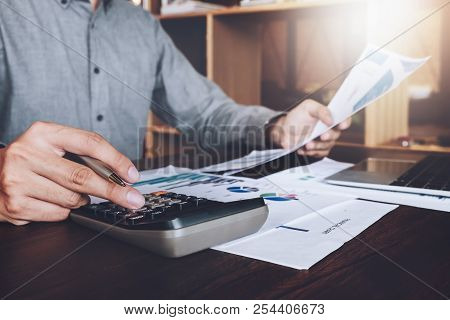 Business Research Loan Application Data Concept, Asian Businessmans Using Calculator And Laptop Comp