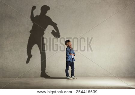 American Baseball Champion. Childhood And Dream Concept. Conceptual Image With Boy And Shadow Of Fit