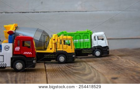 A Truck Concrete Mixer And Tow Truck