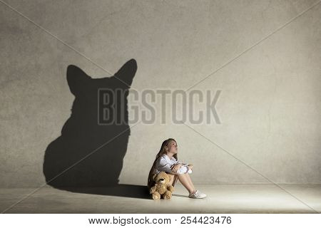 Baby Girl Dreaming About Dog. Childhood And Dream Concept. Conceptual Image With Shadow Of Female Fi