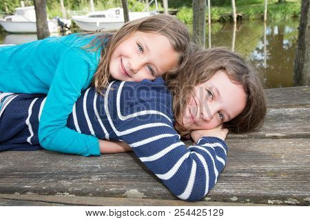 Picture Of Young Sister Hugging Little Child Girl, Closeup Portrait Of Happy Family, Cute Children G