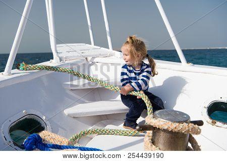 Cutiest Sailor Ever. Boy Adorable Sailor Striped Shirt Yacht Travel Around World. Baby Boy Enjoy Vac