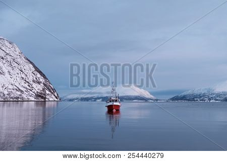 Winter View At The Fishing Boat In The Norwegian Fjord. Seascape Of A Sea In Norway In Winter. Mount
