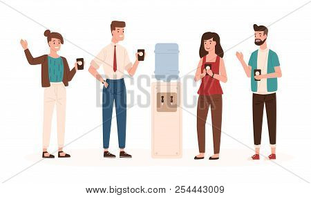 Office Workers Or Colleagues Standing Near Water Cooler Or Dispenser, Drinking And Chatting. Smiling