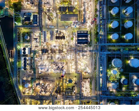 Top View Of Oil Refinery At Night. Aerial View Of Refinery Plant At Sunset. Refinery Factory And Tan