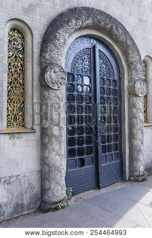Side View Of An Old Metal Door With Rich Ornamentation