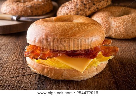 A Delicious Toasted Breakfast Bagel With Egg, Bacon And Cheese.