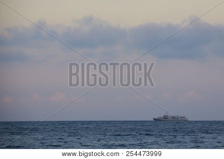Ship In The Sea At Sunset. Summer Beautiful Sunset On The Black Sea, The Ship Is Floating In The Dis