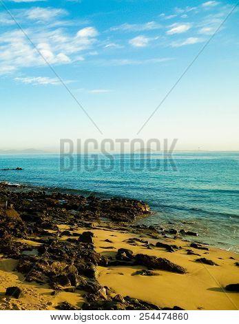 Canarian Coast, Beach, Rocks, And Atlantic Ocean In Playa Blanca. Typical Coast Of Lanzarote Island.