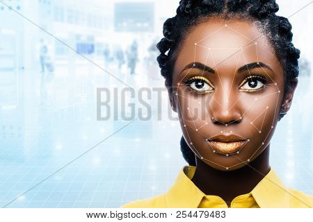 Close Up Portrait Of Attractive African Woman With Facial Recognition Technology. Grid With Referenc
