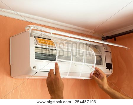 Cleaning Air Conditioning System At Home. Checking Filter In The Air-conditioner. The Concept Of Saf