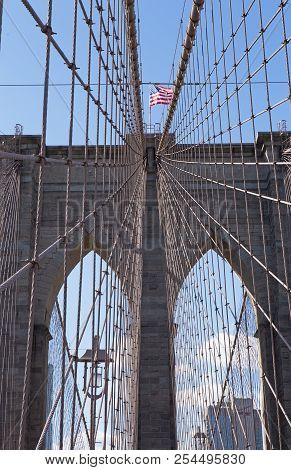 Brooklyn Bridge Archway And Us Flag, New York