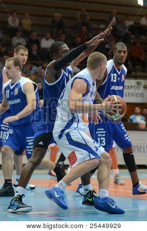 KAPOSVAR, HUNGARY - OCTOBER 15: Nik Raivio (white 33) in action at a Hugarian National Championship basketball game Kaposvar (white) vs. Jaszbereny (blue) on October 15, 2011 in Kaposvar, Hungary.
