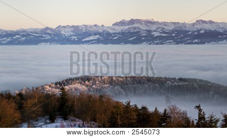 Eastern Swiss Alps At Sunset Above Layer Of Fog