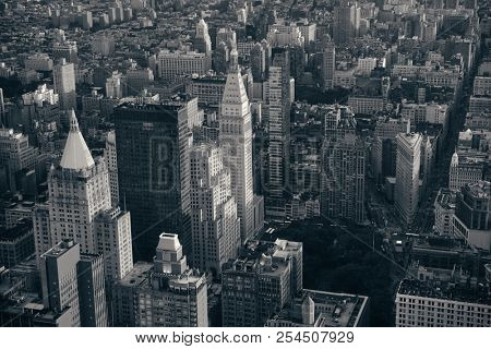 New York City rooftop view with downtown Manhattan skyscrapers and urban cityscape.