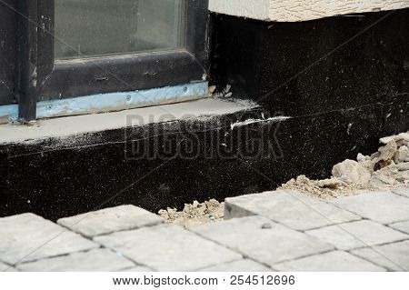 Waterproofing And Insulation House Foundation Wall. Foundation Waterproofing