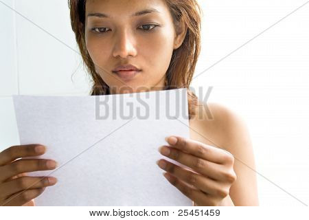 Young woman reading a letter