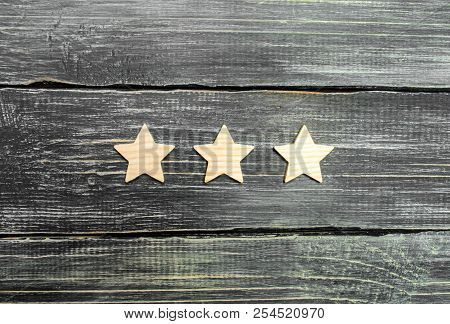 Three Stars On A Dark Background. The Concept Of Rating And Evaluation. The Rating Of The Hotel, Res