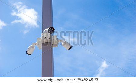 Cctv Surveillance Security Camera Video And Blue Sky Concept - Cctv Surveillance Security Camera Vid